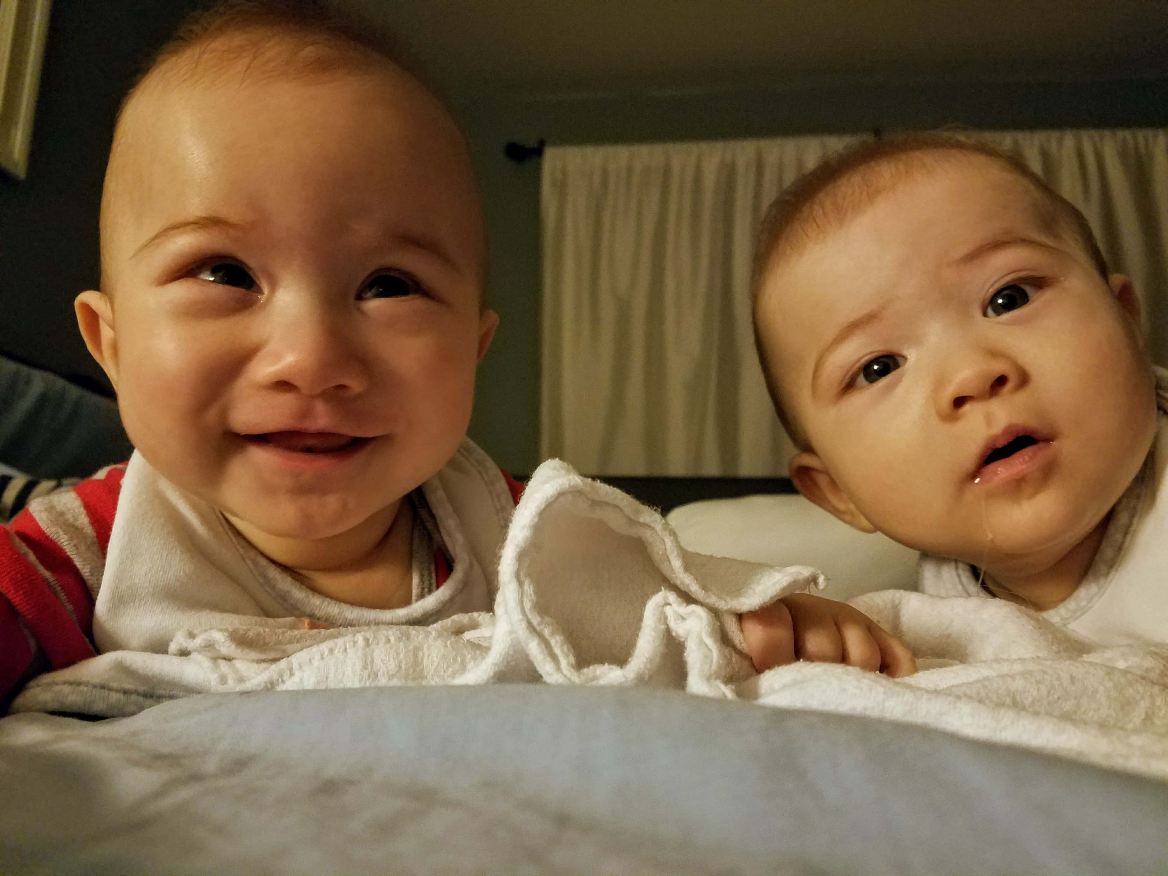 Infant twins relaxing at the hotel