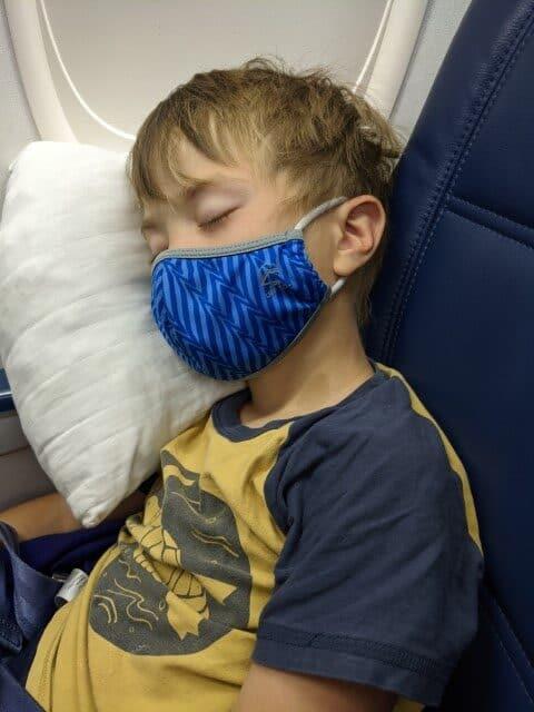 Child sleeping on an overnight flight